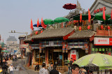 View of Hutong intersection and Bell Tower from Yinding bridge between Houhai and Qianhai lakes Beijing