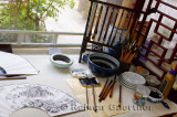 Brushes and ink in a private studio of a professional Chinese painter in a Chichahai area hutong of Beijing