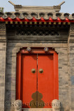 Red door and stonework at estate in Shichahai area hutong in Beijing China