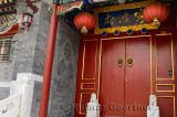 Red door with ornaments at luxury estate in Shichahai area hutong in Beijing China