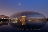 National Centre for the Performing Arts egg at dusk with moon and Great Hall of the People in Beijing