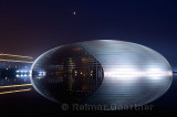 National Centre for the Performing Arts egg at night with moon and Great Hall of the People in Beijing