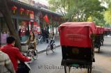 Traffic and line of pedicabs on Qianhai Beiyan street in Shichahai area at Qianhai lake Beijing