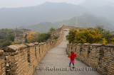 Little girl heading east with towers 11 and 10 on the Mutianyu Great Wall of China north of Beijing