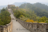 Female tourist heading east to tower 8 on the Mutianyu Great Wall of China north of Beijing