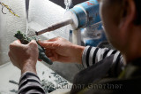 Craftsman carving jade stone with a water cooled diamond dremel in Beijing China
