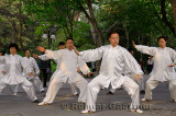 Morning Tai Chi class in position under trees in Zizhuyuan Purple Bamboo Park in Beijing China