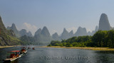 Panorama of tour boat rafts on the Li river Guangxi China with fingerlike karst mountain peaks
