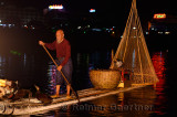 Chinese cormorant fisherman on the Lijiang river in Yangshuo China at night