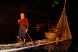 Chinese night fisherman calling to cormorant to catch fish in the Li river Yangshuo China