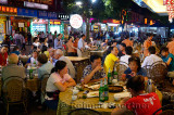 Eating alfresco at outdoor street restaurant at night in Yangshuo China