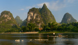 Karst limestone peaks with wild ducks and Cormorant fisherman on the Lijiang river at Yangshuo China