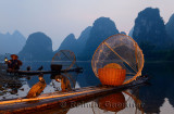 Cormorant fishing raft with wicker basket and net on the shore of the Li river Yangshuo China