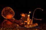 Cormorant fisherman lighting his lantern on the Li river Yangshuo China in early morning darkness