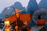 Chinese fisherman with cormorants at dawn on the Li river Yangshuo China