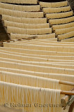 Racks of raw noodles hanging outside to dry in Fuli near Yangshuo China