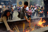 People praying for blessings placing incense sticks at the Ling Yin Buddhist temple Hangzhou China