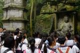 Chinese school children at Ligong stone Pagoda at Feilai Feng limestone grottoes Ling Yin temple Hangzhou China