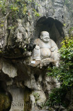 Laughing Buddha scultpure in limestone grotto at Feilai Feng Ling Yin temple Hangzhou China
