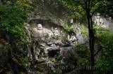 Laughing Buddha scultpure at Feilai Feng limestone grottoes at Ling Yin temple Hangzhou China