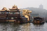 Golden Dragon Boat at West Lake Pleasure boat dock and Leifeng Pagoda Hangzhou China