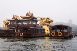 Golden Dragon Boat barge on West Lake with Leifeng Pagoda in Hangzhou China