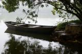 Steel boat in rain moored at Three Pools Mirroring the Moon Island West Lake Hangzhou China