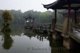 Gazebo walkway and stone pillar at Three Pools Mirroring the Moon Island in West lake Hangzhou China