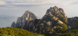 Lotus Peak Jade Screen Tower with hotel and Heavenly City Peak from Brightness Top on Huangshan China