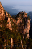 Stone Monkey watching the Sea Peak at first light with fog in valley at Huangshan Mountains China