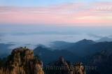 Sunrise red sky at Monkey watching the Sea Peak with fog in valley at Huangshan Mountains China