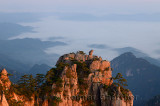 Monkey watching the Sea Peak at first light with fog in valley at Huangshan Mountains China
