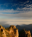 Monkey watching the Sea Peak at sunrise with fog and clouds at Huangshan China