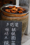 Sign board for street food hot chicken for sale in Hongcun village Anhui Province China