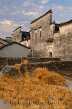 Cords of straw used to collect silkworm cocoons drying in a courtyard of Hongcun China