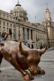 The Bund Financial Bull in Shanghai with Pudong Bank and Customs House clock tower China