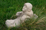 Stone sculpture of monkeys making love in the grass Shanghai Geological Museum China