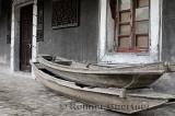Ancient boathouse and abandoned boats at Shanghai Pudong Lingkong Gardens China