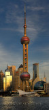 Sunset glow on Oriental Pearl Radio & TV Tower on Pudong east side of Shanghai China