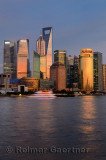 Dusk red glow on high rise towers reflected in Huangpu river of Shanghai China