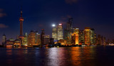 Twilight and night lights of Pudong east side high rise towers of Shanghai China