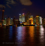 Twilight and Shanghai Pudong night lights reflected in the Huangpu river