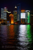 I love Shanghai lights of Pudong high rise towers at night reflected in the Huangpu river China