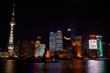 I love Shanghai lights of Pudong high rise towers at night with boats on the Huangpu river China