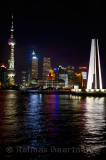 Night lights of Pudong high rise towers and Peoples Heroes Monument Huangpu river Shanghai China