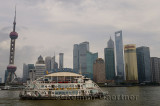Boat cruise on the Huangpu river with Pudong high rise towers in the morning Shanghai China