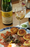 salmon tartar on blinis and Riesling wine.