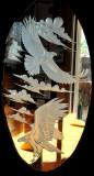 Double-Eagle motiff in glass door to restaurant