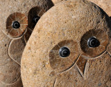 Stone owls waiting in line