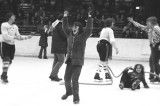 Tug of War on Ice - victorious John Bauslaugh while Diana Johnston lays down on the job